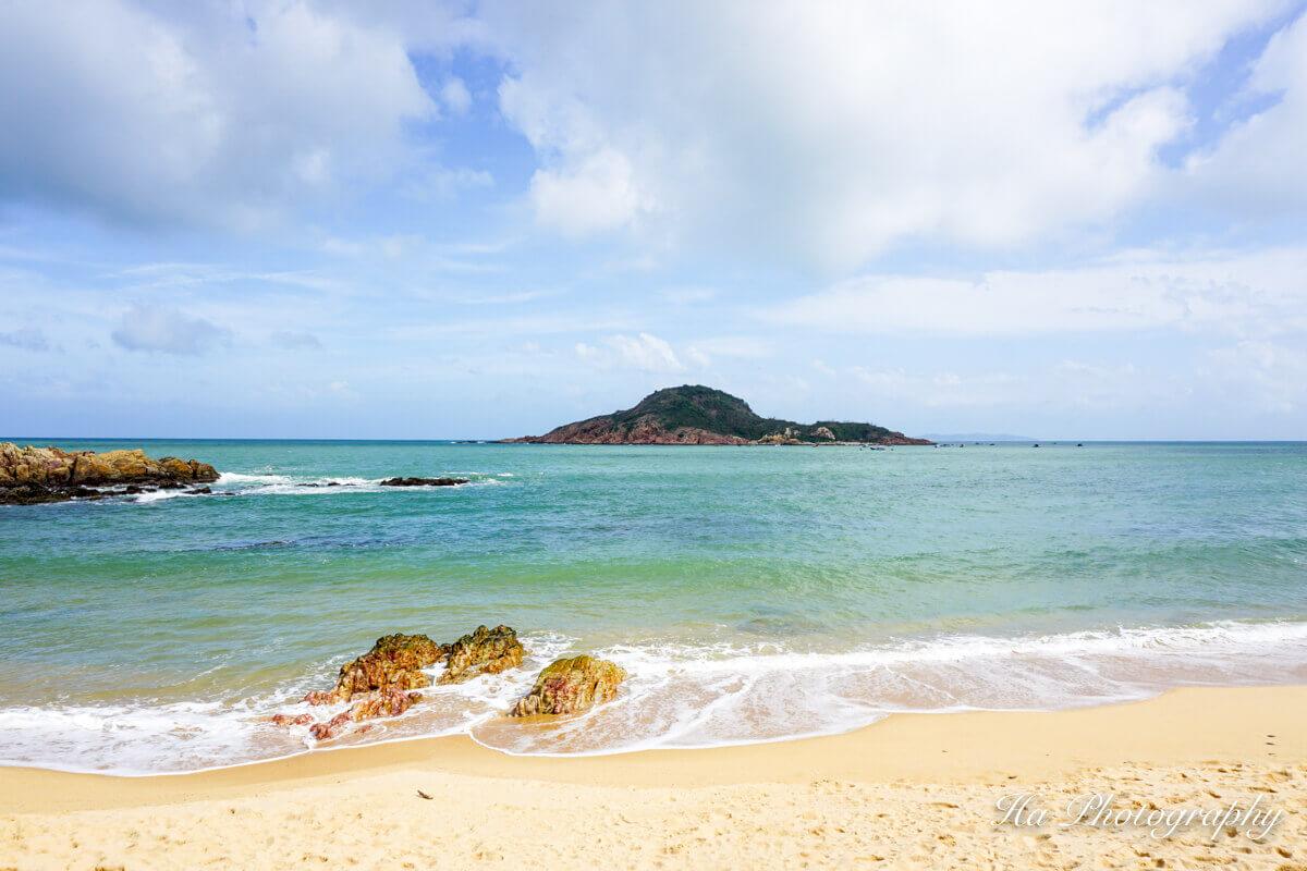 A sandy beach next to the ocean